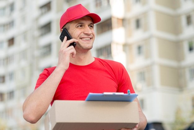 Low angle smiley delivery guy