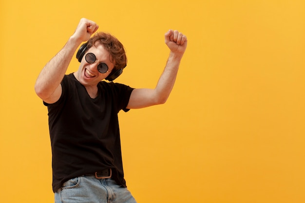 Low angle teenage boy dancing