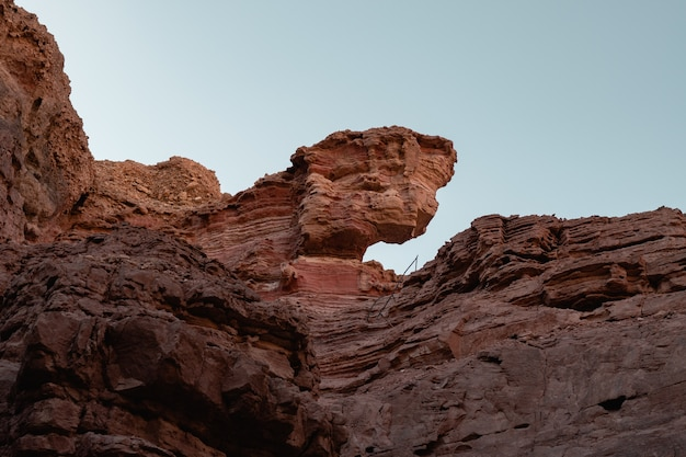 Low angle view of the beautiful rocky cliffs on the desert captured on a sunny day