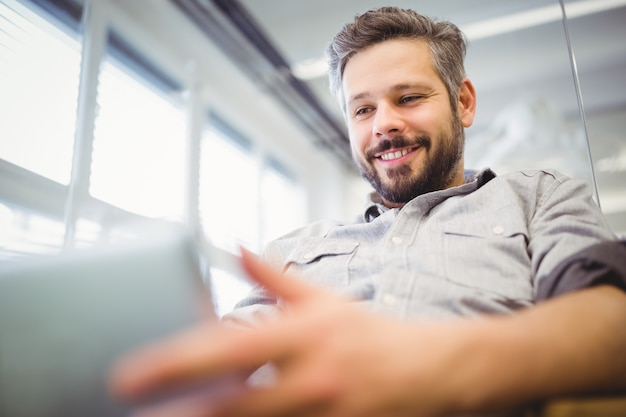 Low angle view of businessman working on laptop in office