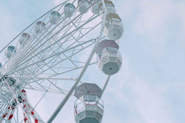 Low angle view of the ferris wheel carousel during daytime under a blue sky