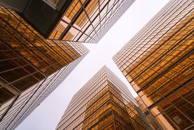Low angle view of gold modern skyscraper business buildings.