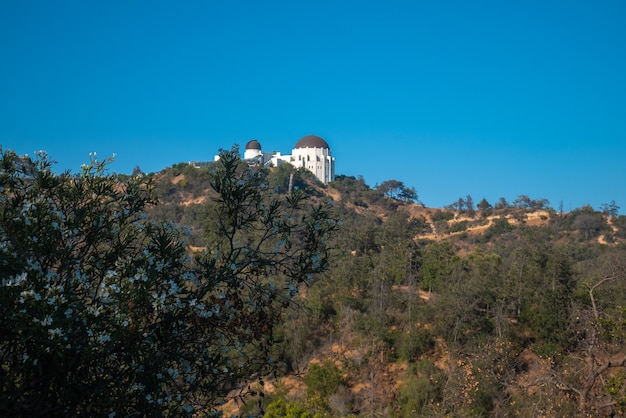 Low angle view of griffith observatory and los angeles city.