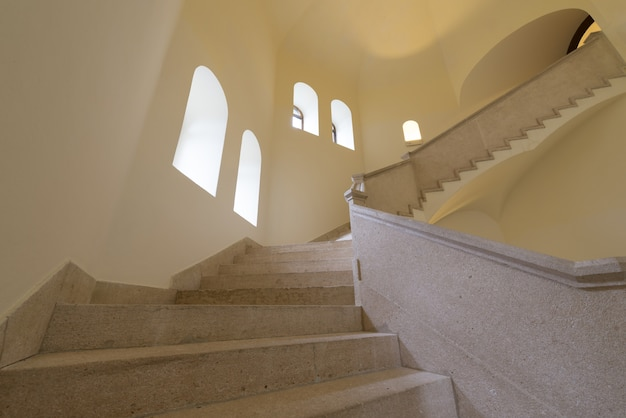Low angle view of milk-white stairs next to windows at daytime