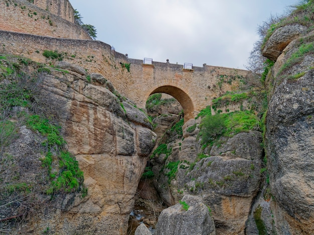Low angle view of old bridge of ronda, spain.