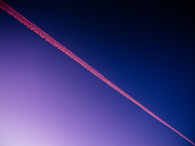 Low angle view of a plane track on a blue sky during the evening - great for backgrounds