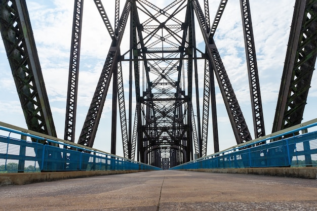 Low angle view of road and truss bridge above water