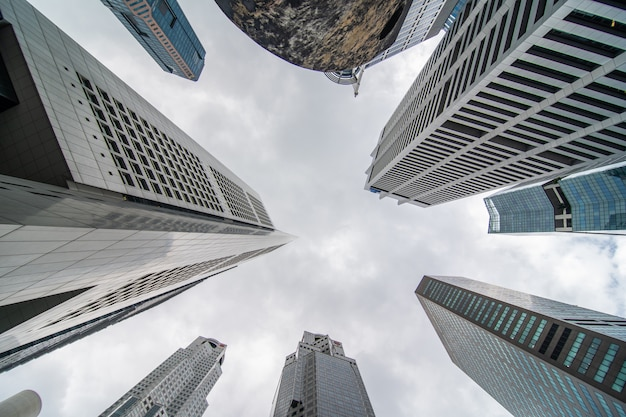 Low angle view of several business and financial skyscraper buildings in singapore.