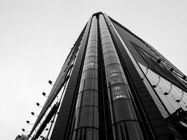 Low angle view of skyscraper with elevators in front
