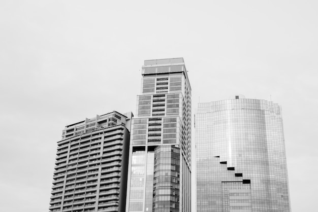 Low angle view of tall corporate buildings in black and white