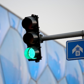 Low angle view of traffic light near beijing national aquatics center, olympic green, beijing, china