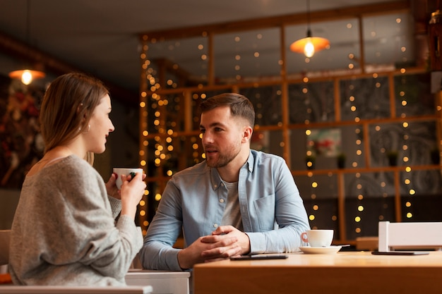 Low angle woman and male at restaurant