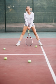 Low angle woman playing tennis