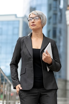 Low angle woman in suit outdoor