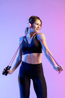 Low angle woman training with jumping rope