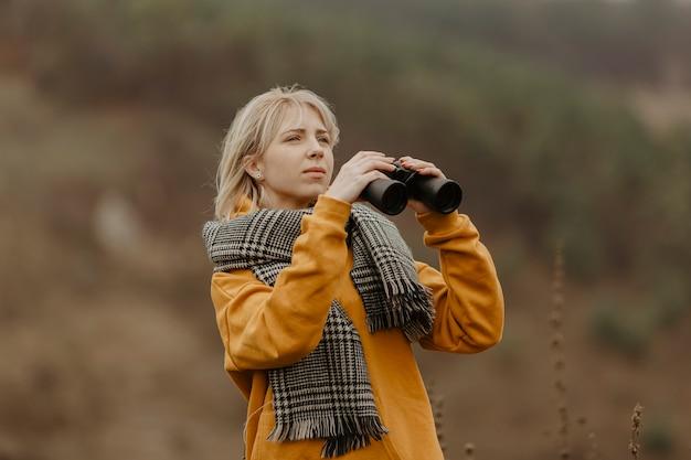 Low angle woman with binocular