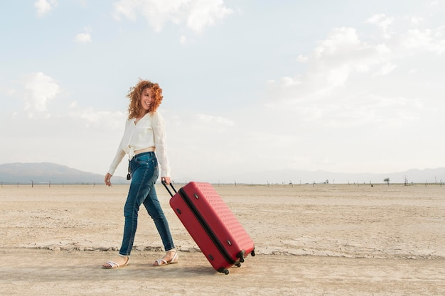 Low angle woman with luggage