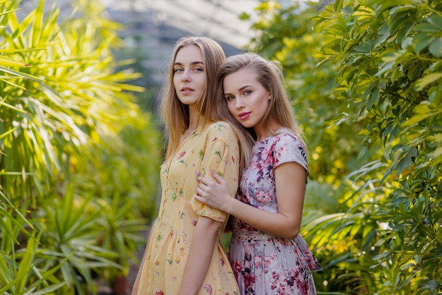 Low angle women posing in foliage middle