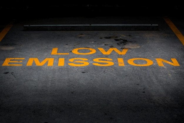 Low emission yellow word on asphalt parking lot