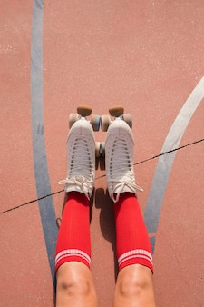 Low section of a female skater with red socks and roller skate