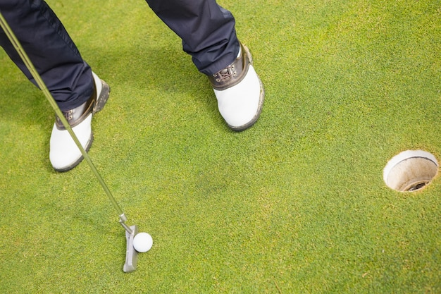 Low section of man playing golf