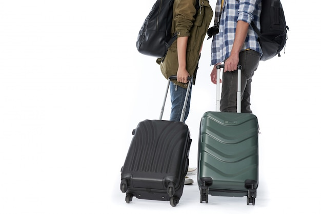 Low section of unrecognizable people with baggage and backpacks