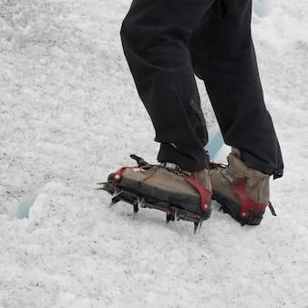 Low section view of man hiking in snow, perito moreno glacier, los glaciares national park, santa cr