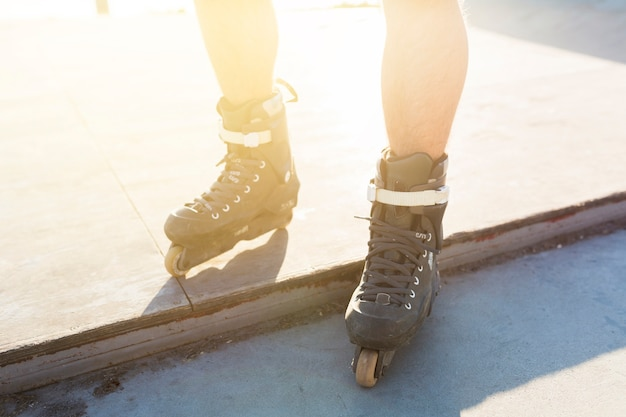 Low section view of a man's feet with rollerskate