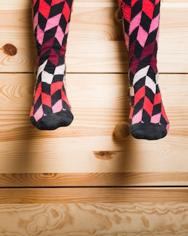 Low section view of a girl's feet with multi colored socks
