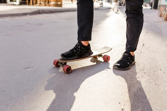Low section view of a skateboarder's feet with skateboard