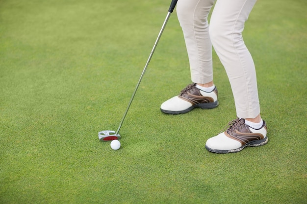 Low section of woman playing golf
