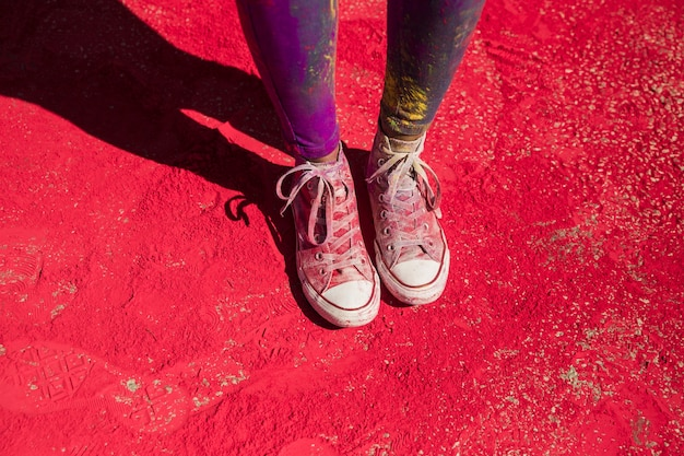 Low section of woman's shoes with holi color powder