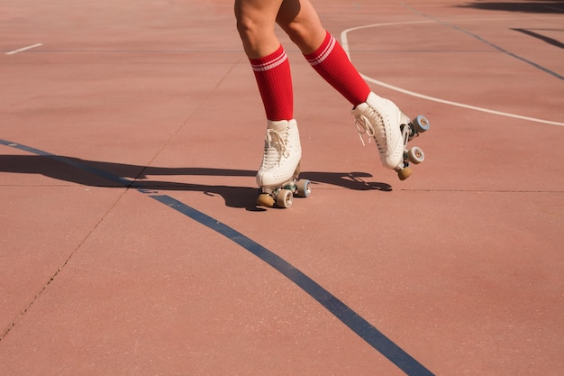 Low section of a woman skating on an outdoor court