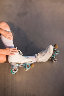 Low section of a woman wearing roller skate