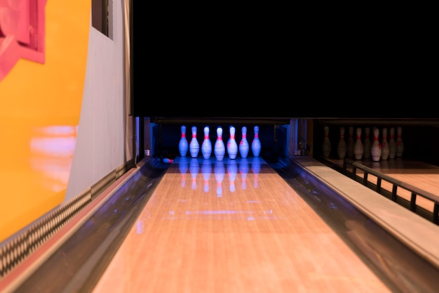 Low view bowling alley with wooden flooer