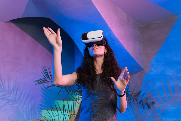 Low view woman playing games on vr set