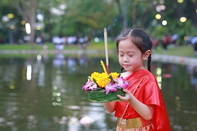 Loy krathong festival, asian child girl in thai traditional dress