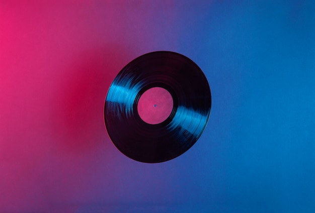 Lp vinyl record lit with blue and red colorful neon light
