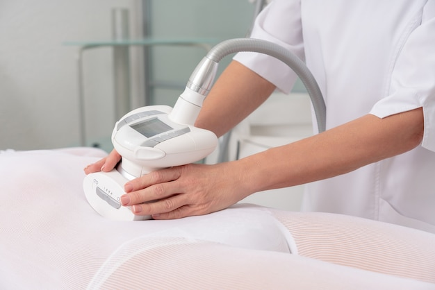 Lpg massage in special white suit, body contouring treatment