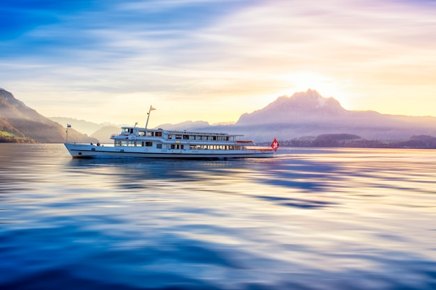 Lucerne boat tour on river with swiss mountain