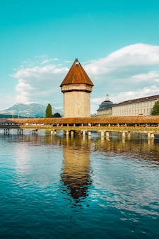 Lucerne city in swiss alps old covered wooden bridge over the river embankment and ancient tower