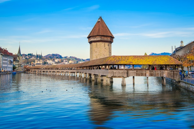 Lucerne, switzerland. historic city center with its famous chapel bridge and mt. pilatus on the background. (vierwaldstattersee),