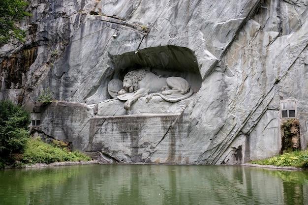 Lucerne, switzerland - july 3, 2017: dying lion of lucerne monument, switzerland