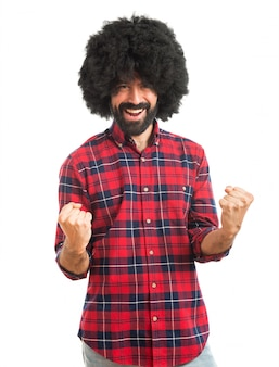 Lucky afro man over white background