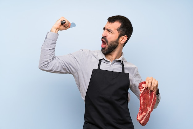 Lucky chef holding a raw meat