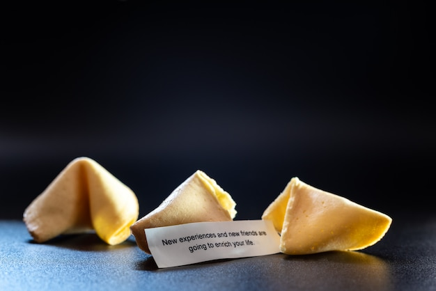 Lucky cookies broken with message to find new friends.
