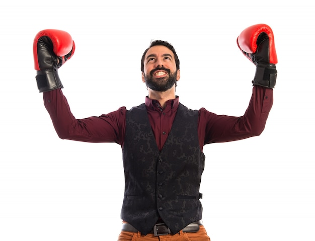 Lucky man wearing waistcoat with boxing gloves