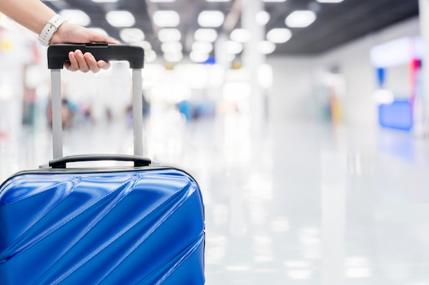 Luggage at airport terminal travel concept