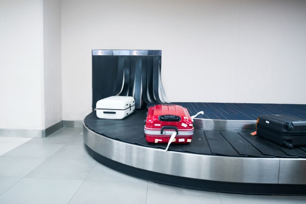 Luggage in arrivals lounge of airport terminal