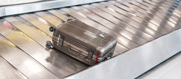 Luggage bag on conveyor belt in the airport